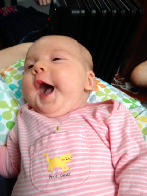 Now that is one happy milk-faced baby!
