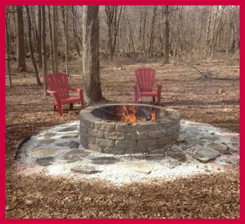 Don't you love the fire pit and the red Adirondeck chairs? Photo courtesy of Peter Darbisi