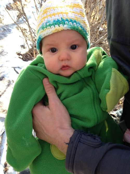 Ava in her Warm Frog Suit.  Our little tadpole!
