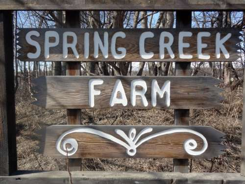Welcoming sign for visitors at Spring Creek Farm in alaska