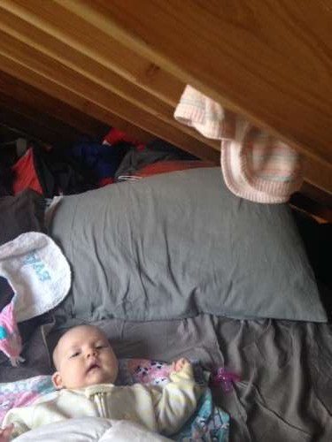 Ava in bed.  Those wooden beams are the ceiling.  The rags are burp cloths that are easy to grab in an emergency late night spit up situation!