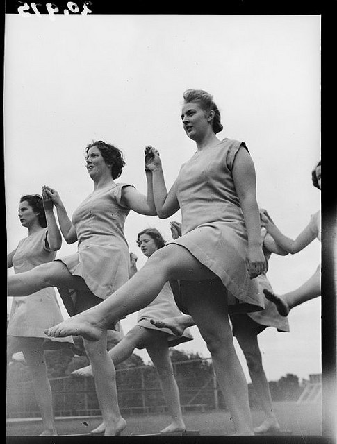 Female trainee physical education instructors performing leg swings, Hutt Valley, Wellington. March 1944