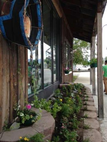 Verdant front to the antique shop.