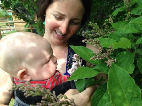 Rural towns leave space for beautiful plants.  Ava smells her first lilacs!