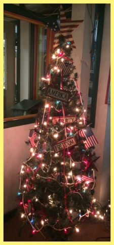 For summer, the tree is done up in red, white, and blue. Past themes include Easter, Back to School, and Halloween, to name a few.