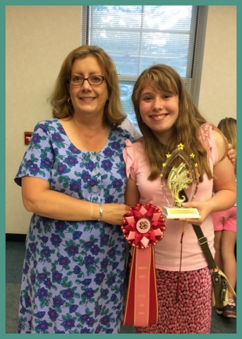 My daughter and her club's leader, Alison Rogers, at Recognition Night, when all 4-h members in the county are recognized for their hard work during the year.