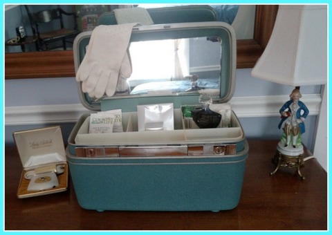 Leave an opened vintage train case stocked with toiletries in your guest room. p