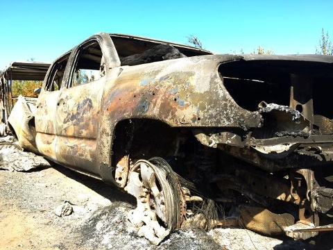 Burnt out truck in aftermath of fire.  Photo courtesy of KTUU.