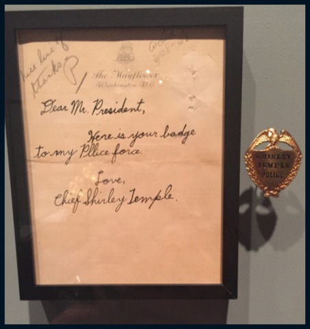 "while my favorite was the badge presented to FDR by Shirley Temple in 1938. On the set of ""Heidi"", she was dubbed the ""chief"" for her ability to keep the others in order."