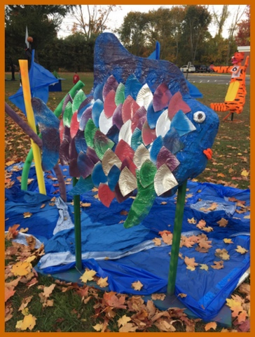 A rainbow fish with foil 'scales' and a tarp for water.