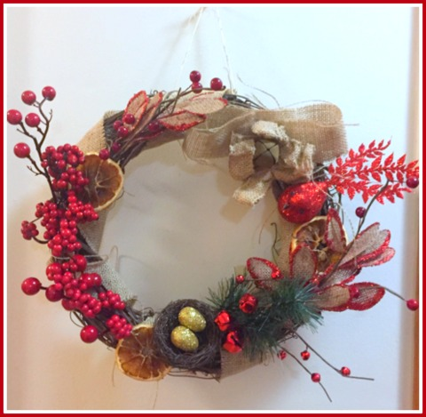 My dad taught me how to make wreaths from grapevine when I was a little girl. I made this one with dried fruit, burlap, and bling!