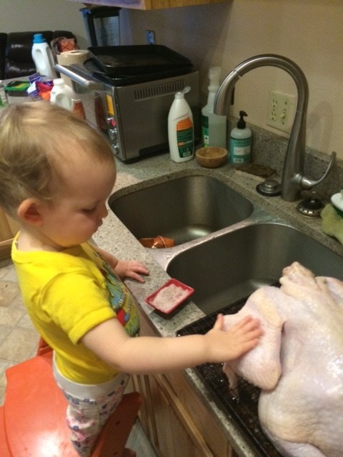 "Maybe she'll take over the turkey prep, too?  Here she is helping me dry brine the ""kurkey."""
