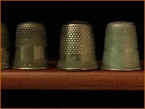 "Fun to find at flea markets, thimbles give clues to their age. Rounded tops are older, while flat-topped one are more ""modern"""