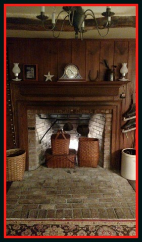 Flea market vintage baskets and back lighting warm up this fireplace in summer.