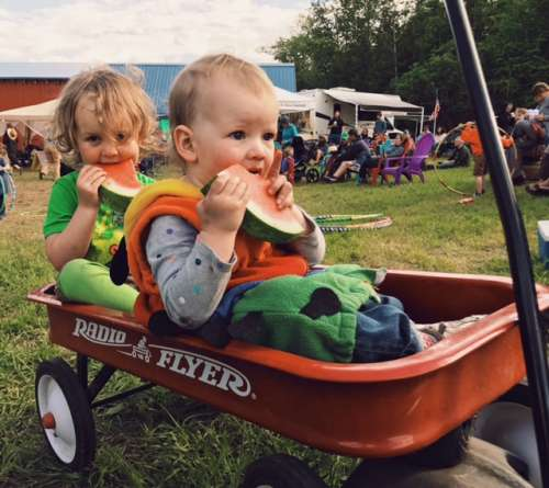 "Evan's photo. His caption: ""What says summer more than eatingbwatermelon in a radio flyer?"""