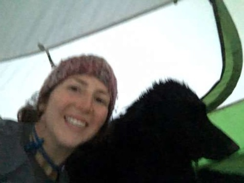 Our only photo in the tent.  Blurry from the wind, Moki obviously enjoying it...