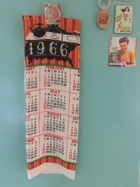 A mint linen tea towel calendar found in an antique store in the Adirondacks now graces the fridge.