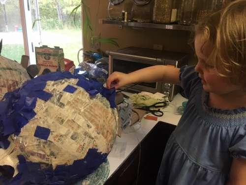 Ava helping me make the blueberry piñata.