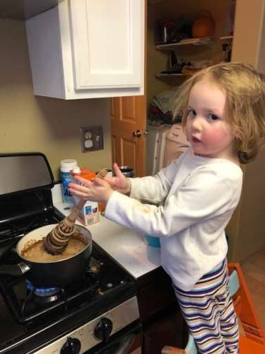 Ava using our official hot chocolate stirrer.