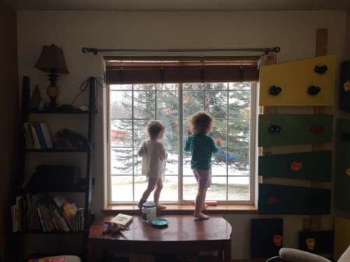 The girls admiring the morning snow fall.
