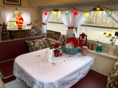 A vintage tablecloth sets the stage in the dinette area.
