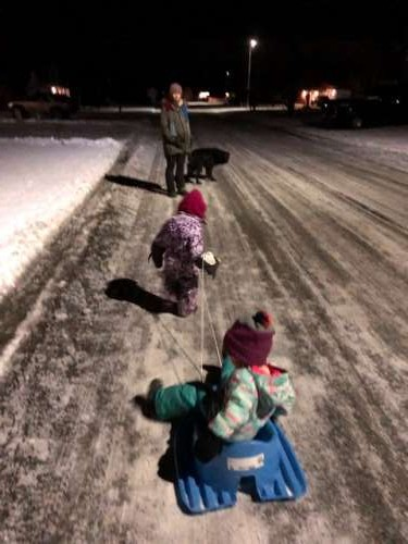 After dinner walk to check out the lights in the neighborhood.  Opal still likes to pull sleds...