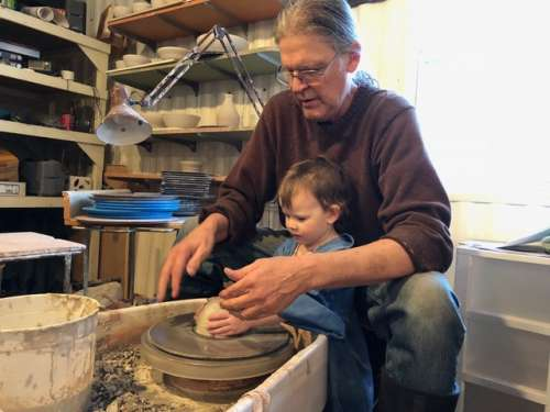 Throwing pots and learning skills from grandpa.