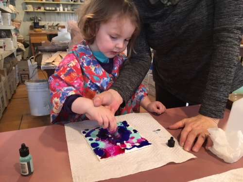 Ava experimenting with alcohol inks.  This is a quick, affordable and pretty easy project to bring some creativity and color to frigid days.