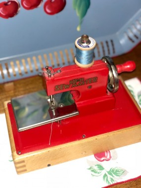 This sweet little machine (I named after MaryJane) sits in my kitchen atop one of a set of cherry themed napkins from the 40's, tying into the theme of my kitchen.