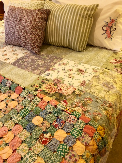 My bed is a mix of new and old. The yo-yo throw and pillow cases are vintage, the quilt is new, mass-produced, and the throw pillows are made by me from vintage-style fabric. Layering makes a bed cozy and inviting.