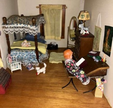 The porcelain kitten  in the little girl's roomwas mine as a child, and part of my original dollhouse.