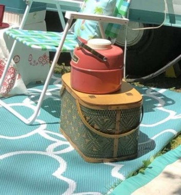 "My large vintage picnic basket is made by Hawkeye. Redmond is another brand with similar baskets. Inside the camper,  it makes great storage, while outside it looks cute and can serve as an outdoor ""end table""."