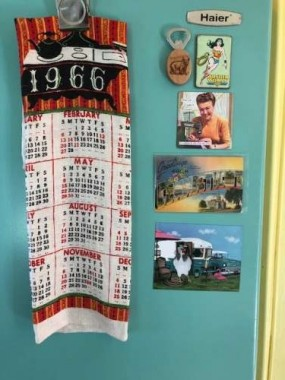 """It took awhile to find a vintage """"Greetings from Connecticut"""" postcard. All the magnets on the fridge are gifts from friends, including the hilarious """"chicken art"""" glamper magnet."""
