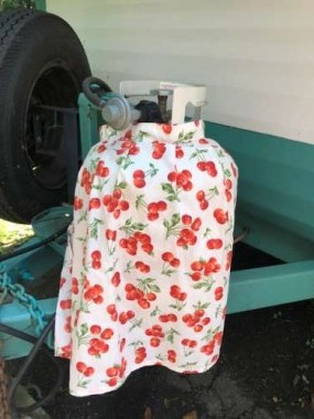 I love MaryJane's idea of covering the propane tank with a vintage apron!