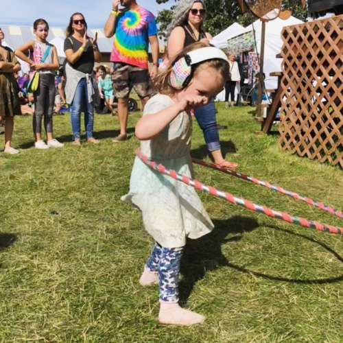 Noise canceling headphones are another option to ensure isolation if hoods and rain aren't abundant.  This is Ava at a music festival a few weeks ago. She's a hula hooping pro!