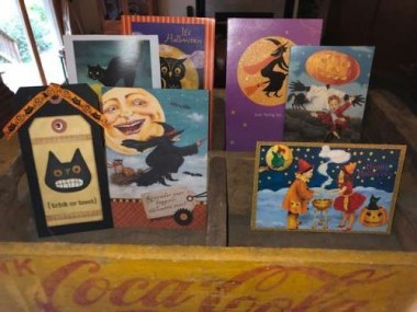 Favorite cards of Halloweens past from my aunt, mom, bff and Farmgirl friends are displayed in an antique soda crate.
