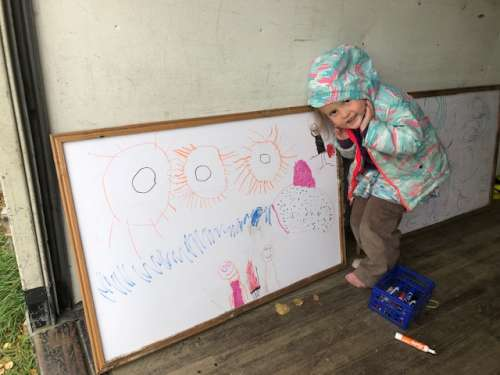 The girls stay occupied while we process the final days of harvest.  Ava was listening to stories and drawing what they were about.