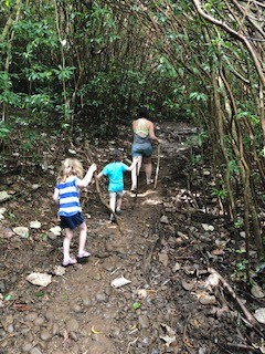 Muddy Jungle trekking Alex with parade of kiddos--definitely a slice of authentic self, here!