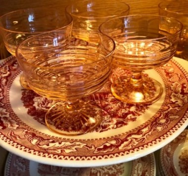 Pink Depression glass sherbet dishes, found at a thrift shop for .50 cents a piece, look dramatic on Memory Lane pink and red dishes, a grocery store bonus in 1965