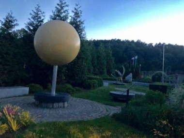 The gigantic bronze sun is a focal point in the outdoor area.