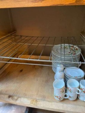 Both the wooden shelf and the wire rack pull out, and offer tons of storage.