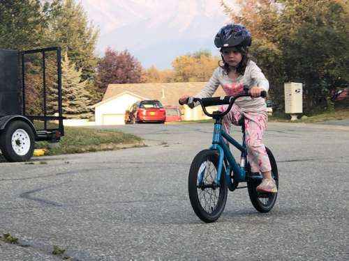 Learning to bike on a smoky day.  Three years old and no training wheels!