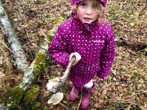 Nature walks yield fun finds! Ava with her portable fungus stick, a gift for me!