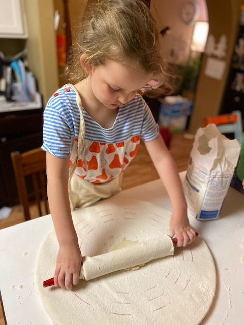 Ava rolling out lefse.