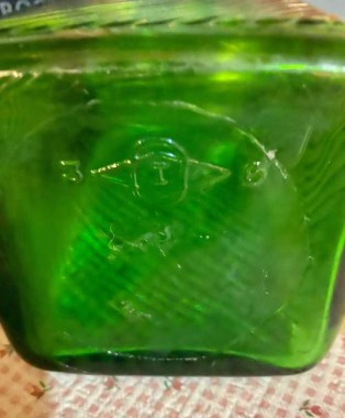 An early maker's mark on the Owens Illinois green glass jar from the 30's