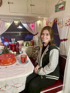 After grueling on-line finals of her first semester in college, Audrey relaxes in the camper with cocoa.