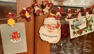 When my daughter was little, this Danish advent calendar held treats. Now, it displays vintage Christmas postcards, and a precious handmade card from a teacher of my father's that holds a photo of my dad with classmates from the 1940s.